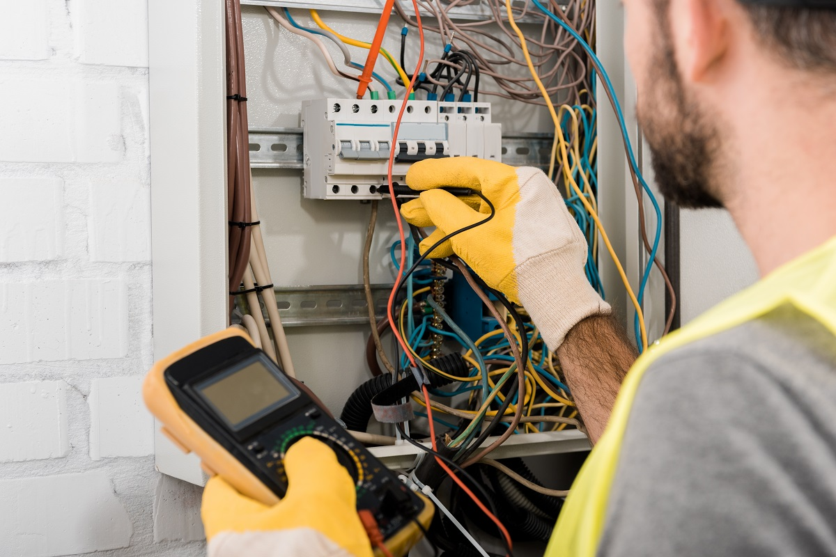 Electrician Checking Wires