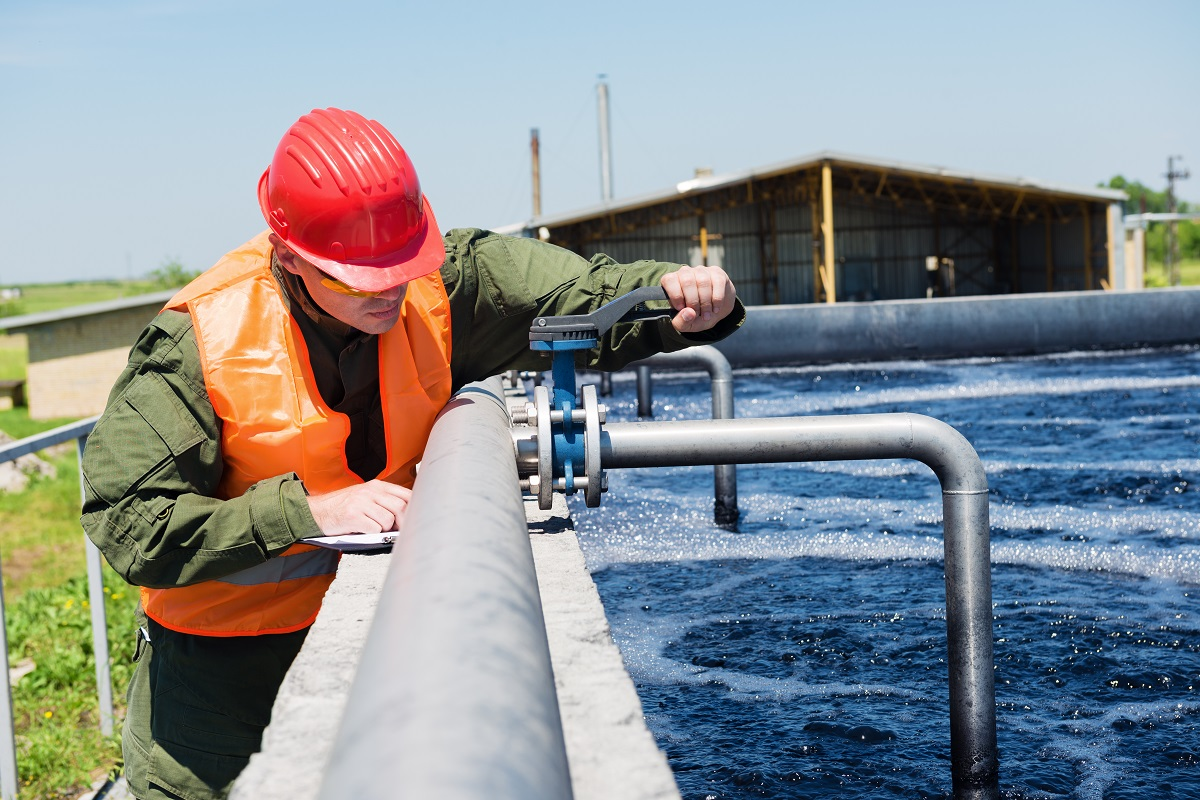 Man Checking The Water In A Treatment Plant