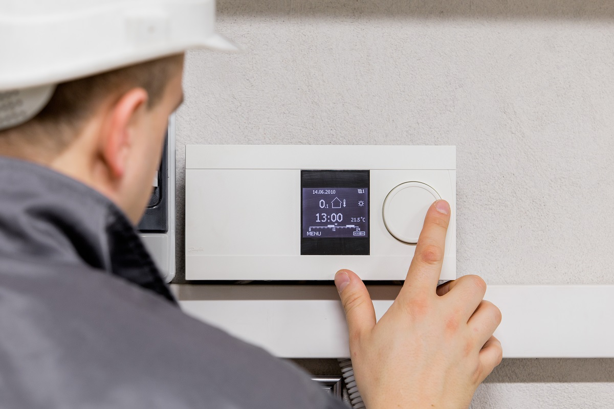 Contractor Installing An Automated Device